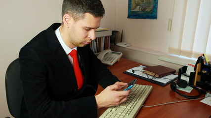 handsome young man looking for meetings in calendar on his phone