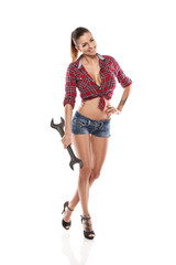 Nice sexy woman mechanic holding wrench