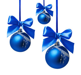 Blue christmas balls with ribbon isolated