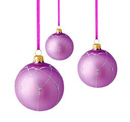 Hanging lilac christmas balls isolated