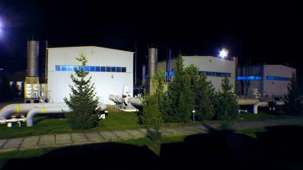timelapse of gas compressor station at night, shot with slider