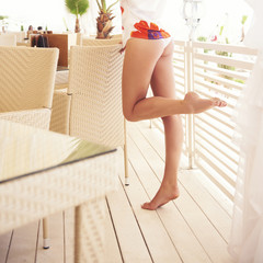 Long legs on the terrace.