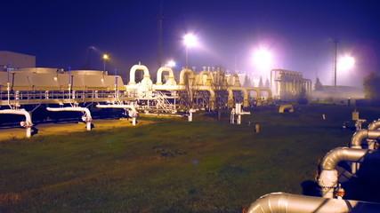 timelapse of installations on main pipeline at night, slider