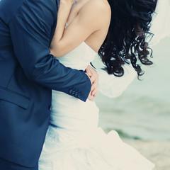Beautiful bride and groom embracing.