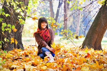 Woman relaxing in the forest, autumn outdoor.