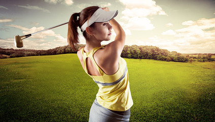 Woman golf player swinging with golf club