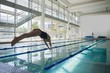 canvas print picture - Fit swimmer diving into the pool at leisure center