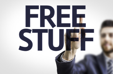 Business man pointing the text: Free Stuff