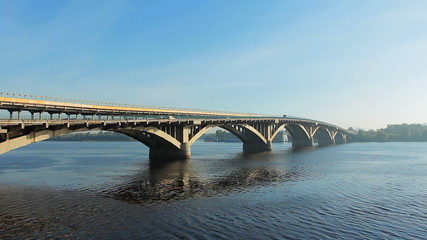 lots of metro trains on bridge ride over Dnipro river, timelapse