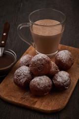 Baked doughnuts with glass of cappucino