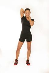 Junge Frau in Trainingskleidung
