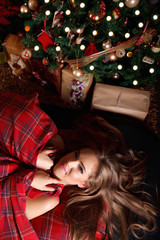 Beautiful woman in the bed alone at Christmas
