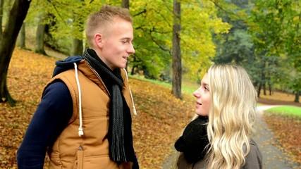 happy couple talk (conversation) - autumn park - couple smiles