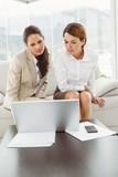 Young businesswomen using laptop