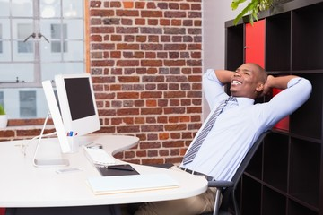 Thoughtful businessman at office desk