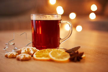 Hot christmas drink with spices and gingerbread