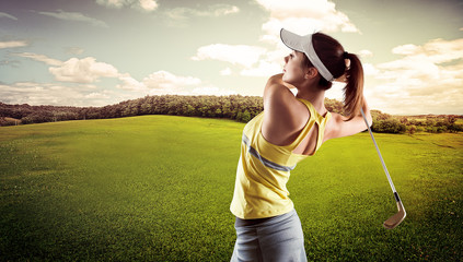 Sporty young female playing golf on the nature.