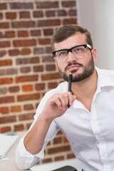 Thoughtful businessman in office