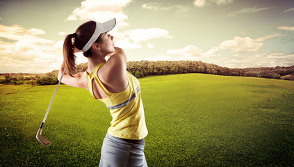 Woman practising golf exercise over beautiful landscape