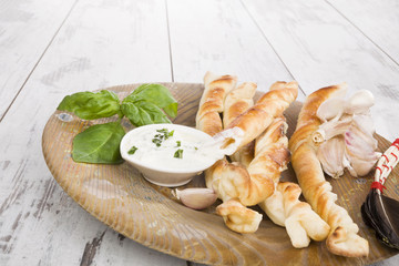 Pizza breadsticks with ingredients.