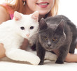 girl holding two cats  on a white background