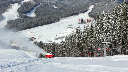snow gun shoots, sideways moving ski lifts in mountains