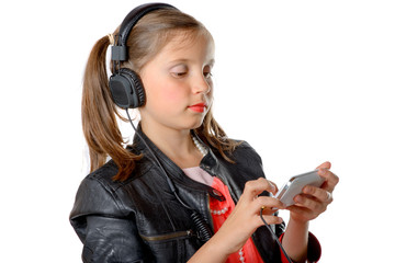 a young girl listening to music on his phone