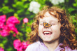 Laughing girl with a butterfly on his nose. - 72319945