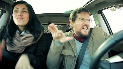 Man and woman dancing crazy in car being stupid