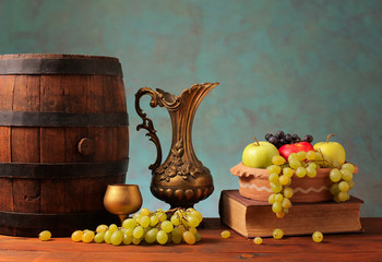 Old wooden barrel and fruits