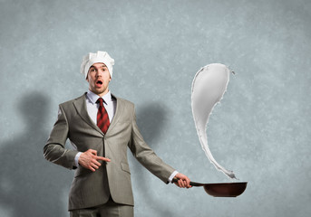 Businessman with pan