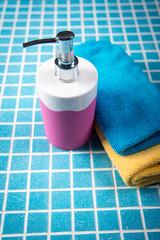 towel and liquid soap