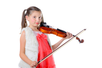 a pretty little girl playing the violin
