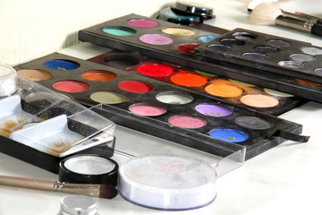 Colorful grease-paint palette. Makeup background.