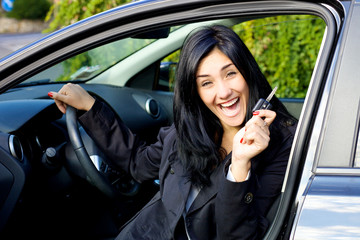 Young woman smiling happy about new car