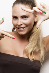 Portrait of Beautiful Blond Woman shows a Sign with Hands