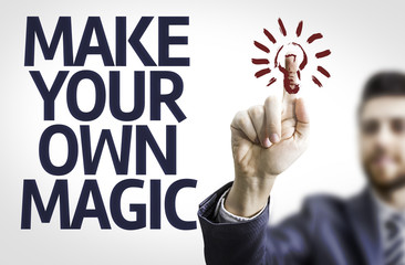 Business man pointing the text: Make Your Own Magic