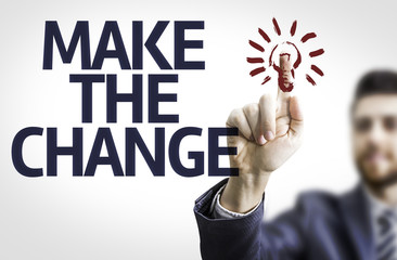 Business man pointing the text: Make the Change