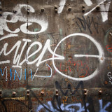 Extreme close up of graffiti on wood door - 72325384