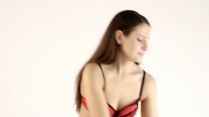 Video of a woman with headphones in red lingerie
