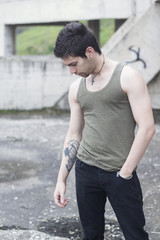 Young depressed tattooed man