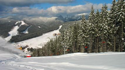 mountains, panorama down to ski lifts and snow gun, timelapse