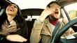 Couple having fun dancing in car happy