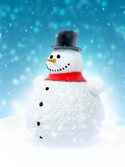 Snowman against the blue sky