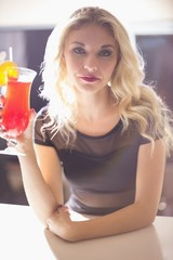 Attractive blonde drinking a cocktail