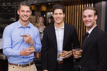 Handsome friends having a drink together