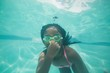 Cute kid posing underwater in pool - 72332368