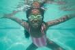 Cute kid posing underwater in pool - 72332386