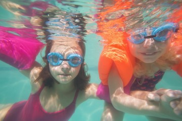 Cute kids posing underwater in pool