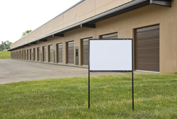 Blank Sign In Front of Warehouse & Industrial